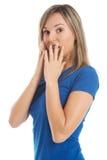 Stående av en kvinna som uttrycker chock, skräck, överraskning. Arkivbild
