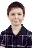 Stående av en lycklig le ung pojke Arkivfoto