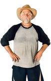 Stående av en mellersta åldrig man med ett skägg och en hatt som isoleras på vit Arkivfoto