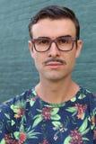 Stående av en moderiktig man med en mustasch royaltyfria foton