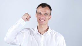 Stående av en mycket upphetsad lycklig ung man som firar framgång Fotografering för Bildbyråer