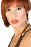 Stående av en rödhårig mankvinna. royaltyfri foto