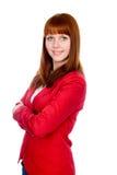 Stående av en redheaded flicka för säker affär. Arkivfoto