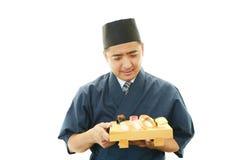 Stående av en sushikock royaltyfri fotografi