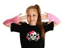 Stående av en ung flicka med punkrockhandskar Arkivbilder