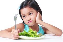 Flicka och grönsaker Arkivbild