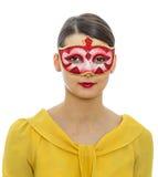 Stående av en ung kvinna med en maskering Royaltyfria Foton