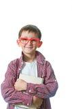 Stående av en ung lycklig pojke i röda anblickar. Fotografering för Bildbyråer