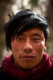 Stående av en ung man från Lhasa, Tibet Arkivbilder