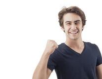 Stående av en ung man med hans lyftta näve Fotografering för Bildbyråer