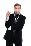 Stående av förvånat hållande övre för affärsman hans pekfinger Arkivfoto