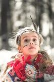 Stående av flickan i dräkt av indianen Fotografering för Bildbyråer