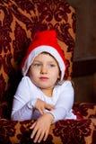 Stående av flickan i en julgran royaltyfria bilder