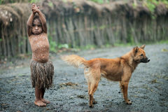 Stående av flickan med en hund Arkivbild