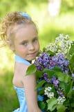 Stående av flickan med lilor Royaltyfri Fotografi