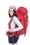 Stående av fotvandrarekvinnan med ryggsäcken som isoleras på den vita backgrouen Royaltyfri Fotografi