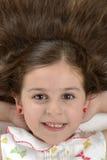 Stående av härligt hår för härlig flicka Royaltyfri Foto