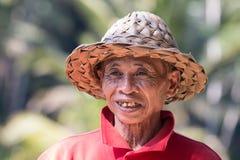 Stående av indonesiskt le för bonde royaltyfria foton