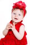 Stående av lite flickan på en vit bakgrund Arkivfoto