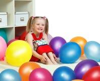 Stående av lite flickan som spelar med bollar Royaltyfria Foton
