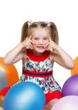 Stående av lite flickan som spelar med bollar Royaltyfri Fotografi