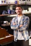Stående av manliga Barber Standing By Cash Register royaltyfria foton