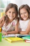 Stående av studera för två härligt små flickor fotografering för bildbyråer