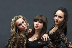 Stående av tre attraktiva sexiga dansare Arkivfoton