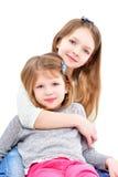 Stående av två gulliga flickor Royaltyfria Foton