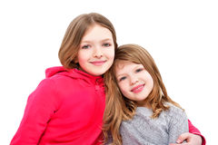 Stående av två gulliga le flickor Royaltyfria Bilder