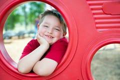 Stående av unga barnet på lekplats royaltyfri foto