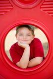 Stående av unga barnet på lekplats fotografering för bildbyråer