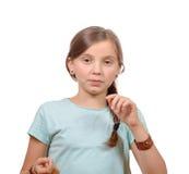 Stående av unga flickan som isoleras på vit Arkivfoto