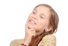 Stående av unga flickan som isoleras på vit Royaltyfri Bild