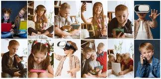 Stående av ungar som använder olika grejer på flerfärgad bakgrund royaltyfri foto