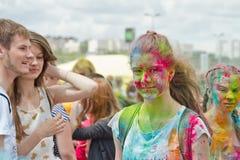 Stående av ungdomarmed olika färger suddade framsidor Fotografering för Bildbyråer
