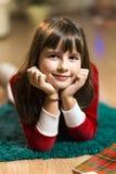 Stående av ungeflickan i jultid Fotografering för Bildbyråer