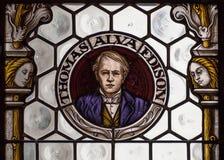 Stående av uppfinnaren Thomas Alva Edison på stadshus för indide för målat glassfönster nytt munich Arkivfoton