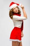 Stående för kvinna för juljultomten hatt isolerad lyckligt le för flicka Arkivfoton
