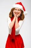 Stående för kvinna för juljultomten hatt isolerad lyckligt le för flicka Arkivbild