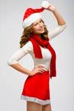 Stående för kvinna för juljultomten hatt isolerad lyckligt le för flicka Royaltyfri Foto