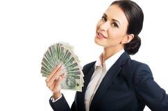 Ståendeaffärskvinna som rymmer ett gem av pengar Arkivfoto