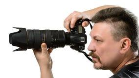 Ståendefotograf med en kamera på en isolerad bakgrund Royaltyfri Fotografi