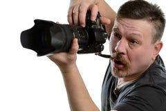 Ståendefotograf med en kamera på en isolerad bakgrund Fotografering för Bildbyråer