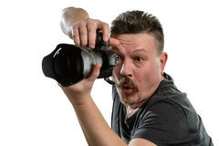 Ståendefotograf med en kamera på en isolerad bakgrund Arkivfoto