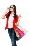 Hänger lös bärande shopping för kvinnan Fotografering för Bildbyråer