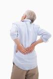 Ståenden av en man som har en back, smärtar arkivbilder