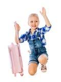 Ståenden av flickan samlar lite resväskasemesterhyra Fotografering för Bildbyråer
