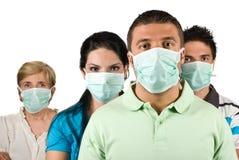 Ståenden av folk skyddar från influensa Royaltyfria Foton