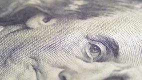 Ståenden av presidenten Benjamin Franklin på hundra dollarräkning roterar lager videofilmer